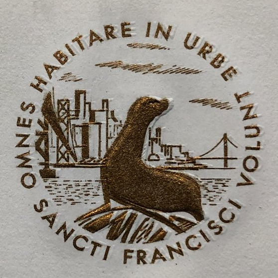 A seal on a piece of paper depicting a seal (well, a sea lion) in front of the San Francisco skyline circa maybe 1965. The Latin surrounding it reads 'OMNES HABITARE IN URBE VOLUNT'